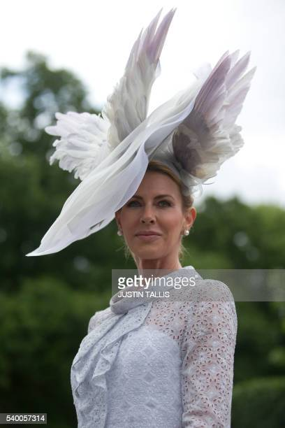 A racegoer poses for photographers on the first day on the first day of the Royal Ascot horse racing meet in Ascot west of London on June 14 2016 /...