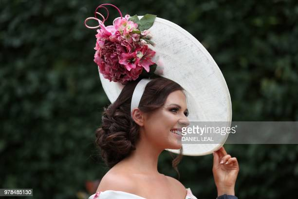 A racegoer poses on day one of the Royal Ascot horse racing meet in Ascot west of London on June 19 2018 The fiveday meeting is one of the highlights...