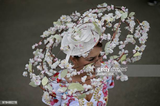 TOPSHOT A racegoer poses on day one of the Royal Ascot horse racing meet in Ascot west of London on June 19 2018 The fiveday meeting is one of the...