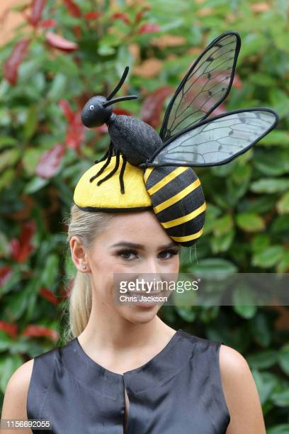 Racegoer poses with her bee hat on day one of Royal Ascot at Ascot Racecourse on June 18, 2019 in Ascot, England.