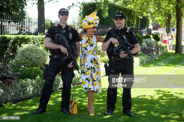 Armed police mix with racegoers as they head towards the gates during Royal Ascot Day 3 at Ascot Racecourse on June 21 2018 in Ascot United Kingdom...