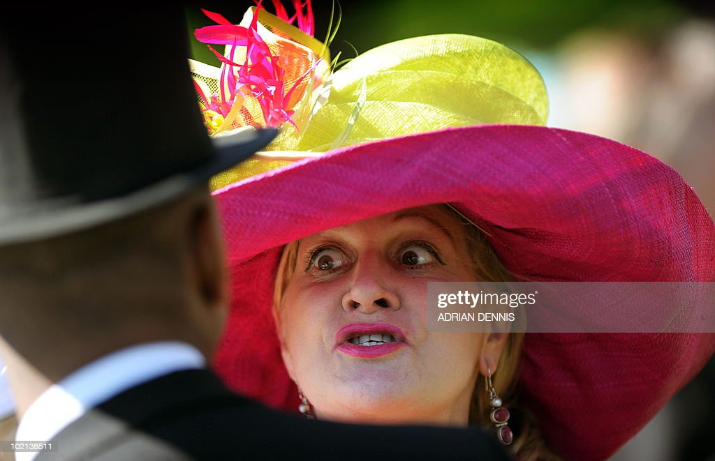 A racegoer reacts as she talks ahead of the second day's horse racing at Royal Ascot, in Berkshire, west of London, on June 16, 2010. The five-day meeting is one of the highlights of the horse racing calendar. Horse racing has been held at the famous Berkshire course since 1711 and tradition is a hallmark of the meeting. Top hats and tails remain compulsory in parts of the course while a daily procession of horse-drawn carriages brings the Queen to the course.