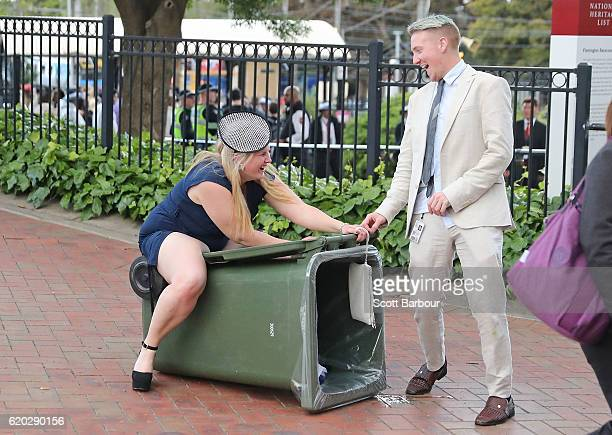 A racegoer sits on a rubbish bin following 2016 Melbourne Cup Day at Flemington Racecourse on November 1 2016 in Melbourne Australia