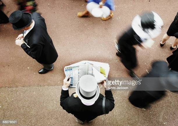 Racegoer studies the form in the crowd on the third day of Royal Ascot 2005, Ladie's Day, at York Racecourse on June 16, 2005 in York, England. One...