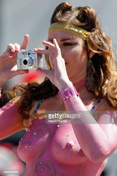 A racegoer takes a photo during the Casino NZ Trotting Cup Day at Addington Raceway on November 9 2010 in Christchurch New Zealand