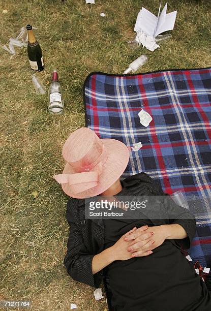 A racegoer takes a rest on Ladies Day the third day of Royal Ascot at the Ascot Racecourse on June 22 2006 in Berkshire England The event has been...