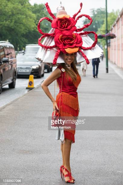 Racegoer Tracy Rose arrives at Royal Ascot for Ladies Day wearing a hat featuring two large red roses on 17th June 2021 in Ascot, United Kingdom....