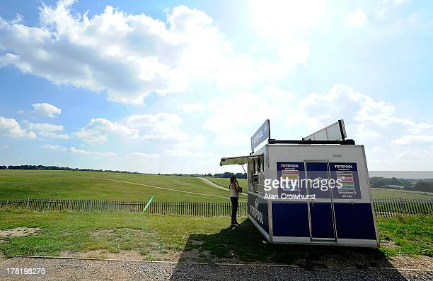 A racegoer visits a bookmaker stand in the Lonsdale enclosure at Epsom racecourse on August 27 2013 in Epsom England