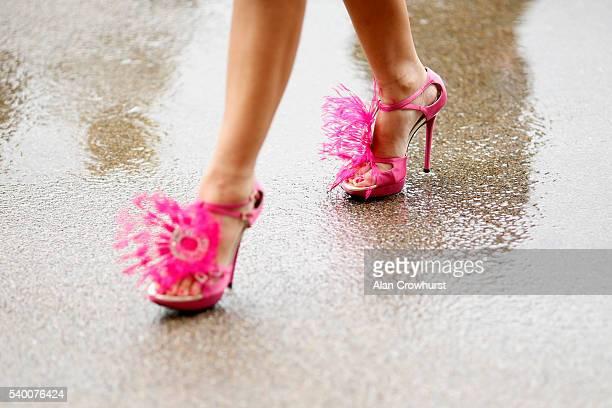 A racegoer walks through the rain at Ascot Racecourse on June 14 2016 in Ascot England