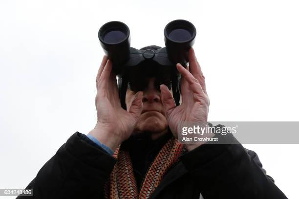A racegoer watches the action at Ludlow racecourse on February 8 2017 in Ludlow England