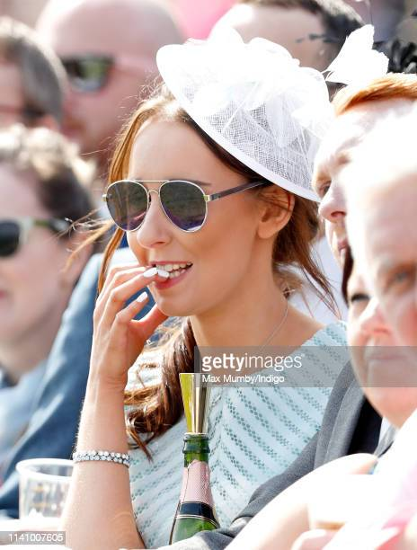 A racegoer watches the racing on day 3 'Grand National Day' of The Randox Health Grand National Festival at Aintree Racecourse on April 6 2019 in...