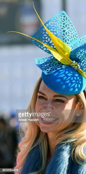 A racegoer wearing a fashionable hat attends Ladies Day at Cheltenham Festival on March 15 2017 in Cheltenham England
