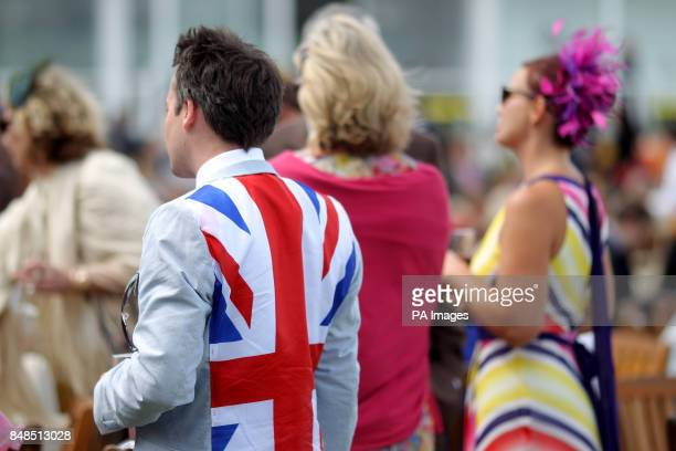 A racegoer wearing a Union Jack flag stitched into his suit jacket at Goodwood Racecourse