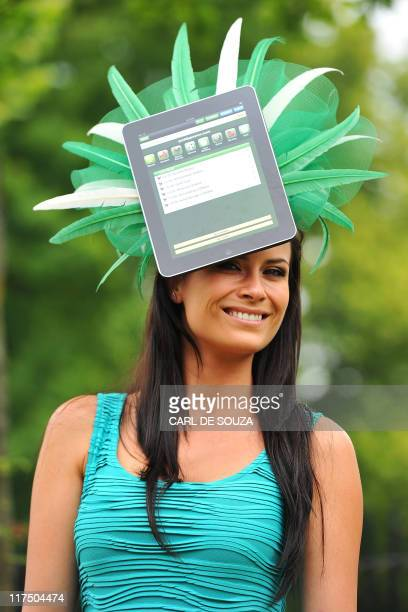 A racegoer wears a hat with an iPad design on the second day of the annual Royal Ascot horse racing event near Windsor west of London in Berkshire on...