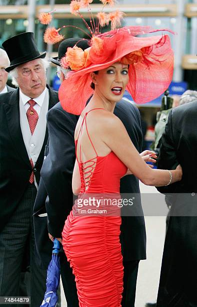 Racegoer wears a sexy red dress and traditional Ascot fashion hat to Ladies Day of Royal Ascot Races on June 21 2007 in Ascot England