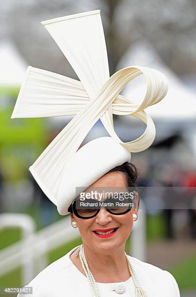 A racegoer wears an ornate hat during Day 1 of the Aintree races at Aintree Racecourse on April 3 2014 in Liverpool England