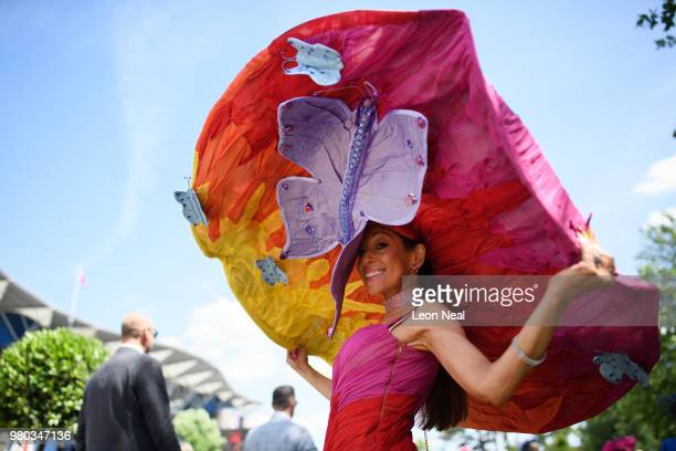 A racegoer wears an outsize hat for Ladies Day during Royal Ascot Day 3 at Ascot Racecourse on June 21 2018 in Ascot United Kingdom Royal Ascot is...