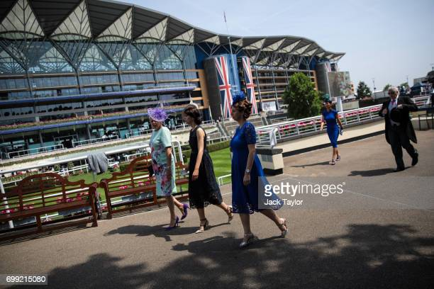 Racegoers arrive at Royal Ascot 2017 at Ascot Racecourse on June 21 2017 in Ascot England The fiveday Royal Ascot meeting is one of the highlights of...