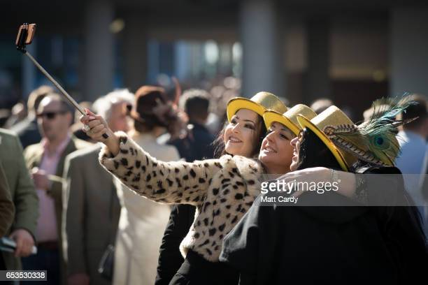 Racegoers arrive at the Cheltenham Racecourse on Ladies Day the second day of the Cheltenham Festival on March 15 2017 in Cheltenham England...