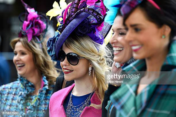 Racegoers arrive at the course during Ladies Day of the Cheltenham Festival at Cheltenham Racecourse on March 16 2016 in Cheltenham England