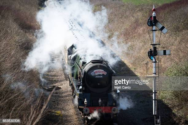 Racegoers arrive by historic steam train at the Cheltenham Racecourse on Ladies Day the second day of the Cheltenham Festival on March 15 2017 in...