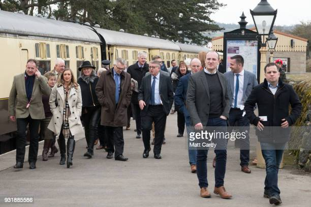 Racegoers arrive by the historic Merchant Navy class Penisular and Oriental steam train at the Cheltenham Racecourse station for Ladies Day on March...