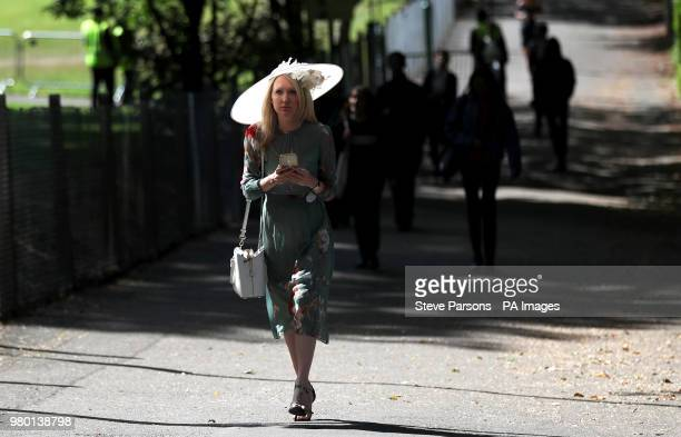 Racegoers arrive for day three of Royal Ascot at Ascot Racecourse.