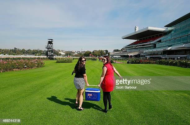 Racegoers arrive to attend Melbourne Racing at Flemington Racecourse on April 11 2015 in Melbourne Australia