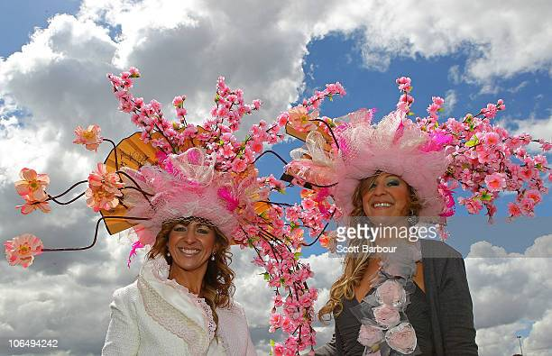Racegoers attend Crown Oaks Day at Flemington Racecourse on November 4 2010 in Melbourne Australia