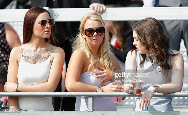 Racegoers attend day 1 'Grand Opening Day' of the Crabbie's Grand National Festival at Aintree Racecourse on April 9 2015 in Liverpool England