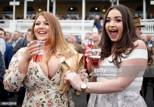 Racegoers attend day 1 of the Randox Health Grand National Festival at Aintree Racecourse on April 6 2017 in Liverpool England