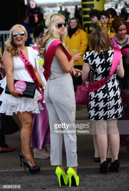 Racegoers attend Day 2 Ladies Day of the Aintree races at Aintree Racecourse on April 4 2014 in Liverpool England