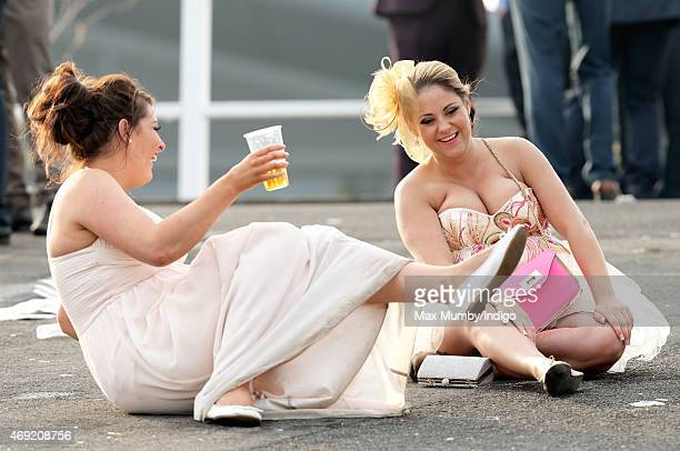 Racegoers attend day 2 'Ladies Day' of the Crabbie's Grand National Festival at Aintree Racecourse on April 10 2015 in Liverpool England