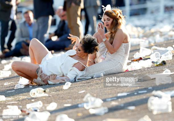 Racegoers attend day 2 'Ladies Day' of the Randox Health Grand National Festival at Aintree Racecourse on April 7 2017 in Liverpool England