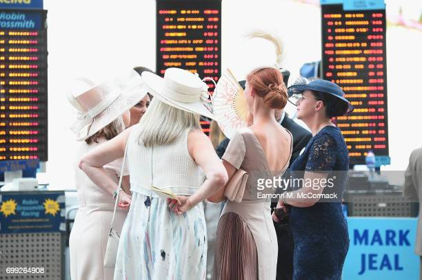 Racegoers attend day 2 of Royal Ascot at Ascot Racecourse on June 21 2017 in Ascot England