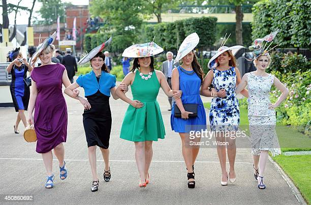 Racegoers attend Day 3 of Royal Ascot at Ascot Racecourse on June 19 2014 in Ascot England