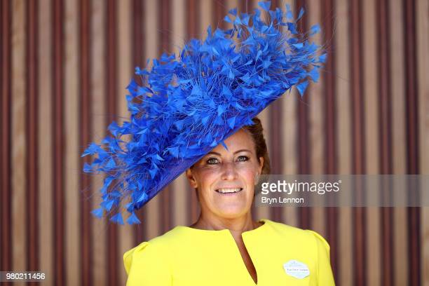 Racegoers attend day 3 of Royal Ascot at Ascot Racecourse on June 21 2018 in Ascot England