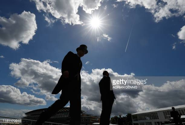 Racegoers attend day four of the Royal Ascot horse racing meet, in Ascot, west of London, on June 21, 2019. - The five-day meeting is one of the...