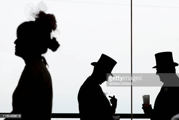 TOPSHOT Racegoers attend day one of the Royal Ascot horse racing meet in Ascot west of London on June 18 2019 The fiveday meeting is one of the...