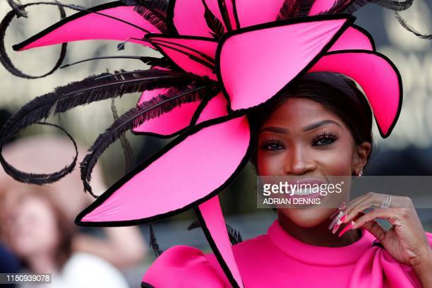 TOPSHOT Racegoers attend day three of the Royal Ascot horse racing meet in Ascot west of London on June 20 2019 The fiveday meeting is one of the...