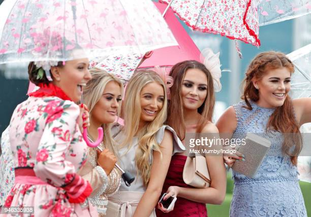 Racegoers attend day two 'Ladies Day' of The Randox Health Grand National Festival at Aintree Racecourse on April 13 2018 in Liverpool England