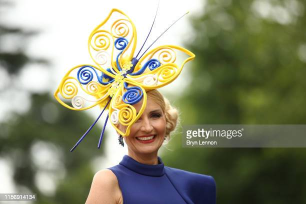 Racegoers attend day two of Royal Ascot at Ascot Racecourse on June 19 2019 in Ascot England