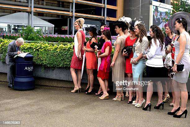 Racegoers attend Ladies Day at Royal Ascot at Ascot racecourse on June 21, 2012 in Ascot, England.