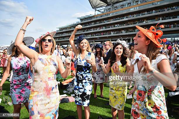 Racegoers attend Ladies Day at Royal Ascot Racecourse on June 18, 2015 in Ascot, England. The Royal Ascot horse race meeting runs from June 16 2015,...