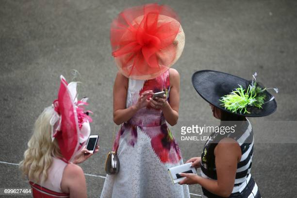 Racegoers attend Ladies Day at the Royal Ascot horse racing meet, in Ascot, west of London, on June 22, 2017. The five-day meeting is one of the...