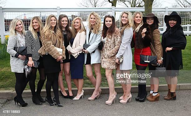 Racegoers attend Ladies Day day 2 of The Cheltenham Festival at Cheltenham Racecourse on March 12 2014 in Cheltenham England