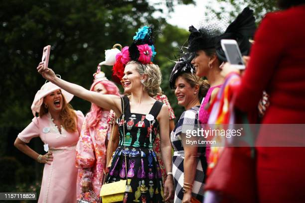 Racegoers attend Ladies Day three of Royal Ascot at Ascot Racecourse on June 20 2019 in Ascot England