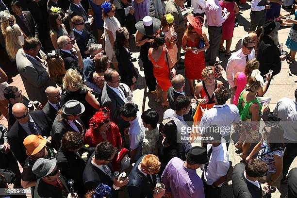 Racegoers attend Melbourne Cup Day at Flemington Racecourse on November 5 2013 in Melbourne Australia