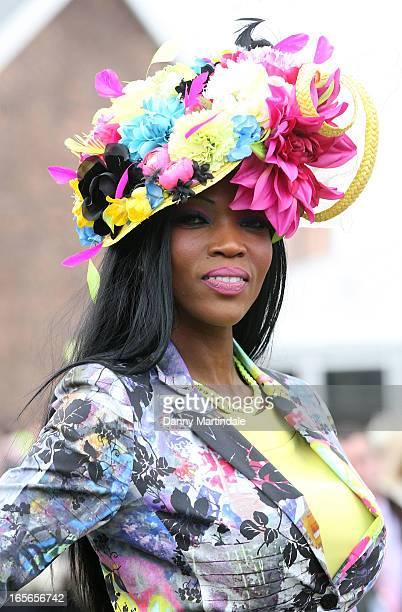 Racegoers attends Ladies Day at Aintree Racecourse on April 5 2013 in Liverpool England