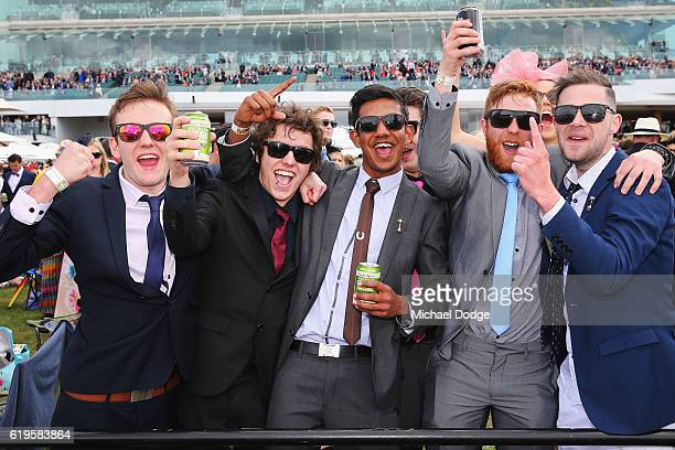 Racegoers celebrate a win on Melbourne Cup Day at Flemington Racecourse on November 1 2016 in Melbourne Australia
